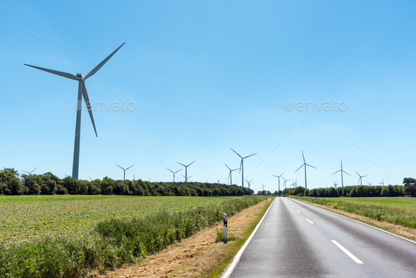Wind power plants and a country road  - Stock Photo - Images