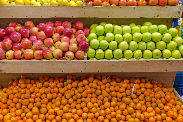 Mandarins and apples for sale - Stock Photo - Images