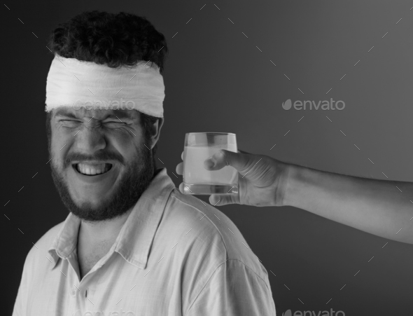 Man with head bandage - Stock Photo - Images