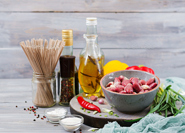 Raw chicken hearts. Ingredients for cooking stir-fry and buckwheat noodles. Chinese cuisine - Stock Photo - Images