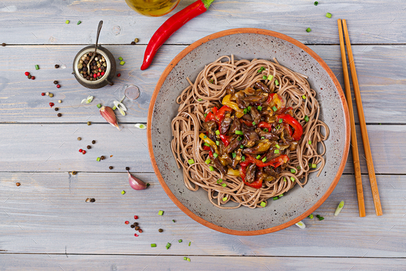 Stir fry from chicken hearts, paprika, onions and buckwheat noodles. Top view - Stock Photo - Images
