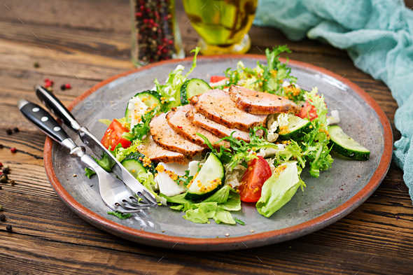 Veal salad with fresh vegetables. Dietary food. Meat salad. - Stock Photo - Images