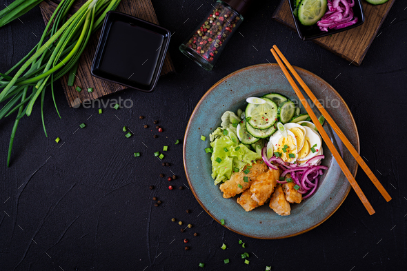 Salad from eggs, fried fish and fresh vegetables. Asian cuisine. Top view - Stock Photo - Images