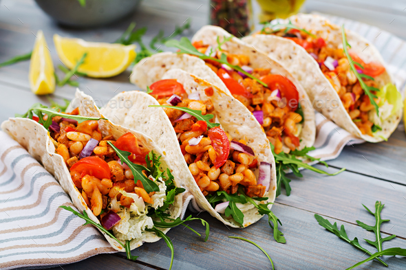 Mexican tacos with beef, beans in tomato sauce and salsa - Stock Photo - Images