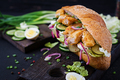 Baguette sandwich with fish, egg, pickled onions and lettuce leaves. - PhotoDune Item for Sale