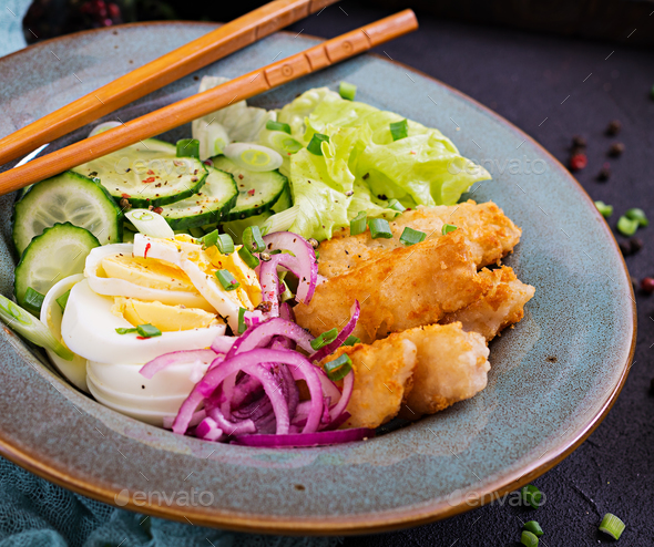 Salad from eggs, fried fish and fresh vegetables. Asian cuisine. - Stock Photo - Images