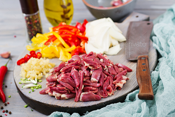 Ingredients for cooking stir-fry from chicken hearts, paprika and onions. Chinese cuisine - Stock Photo - Images