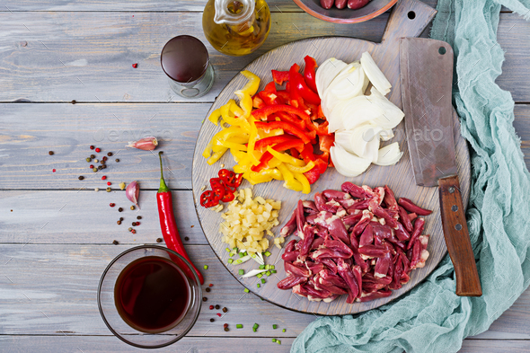 Ingredients for cooking stir-fry from chicken hearts, paprika and onions. Chinese cuisine. Top view - Stock Photo - Images