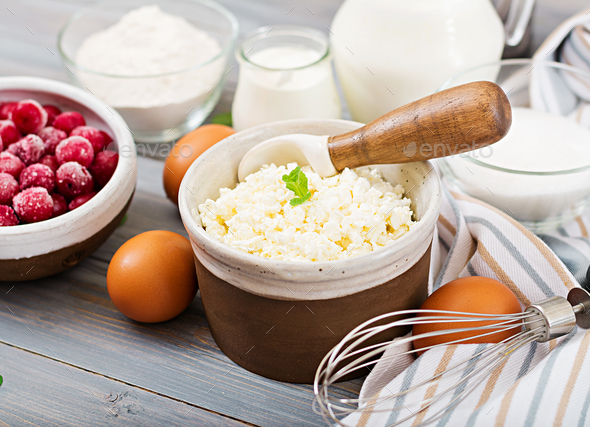 Ingredients for the preparation of cottage cheese casserole with cherries. Tasty breakfast - Stock Photo - Images
