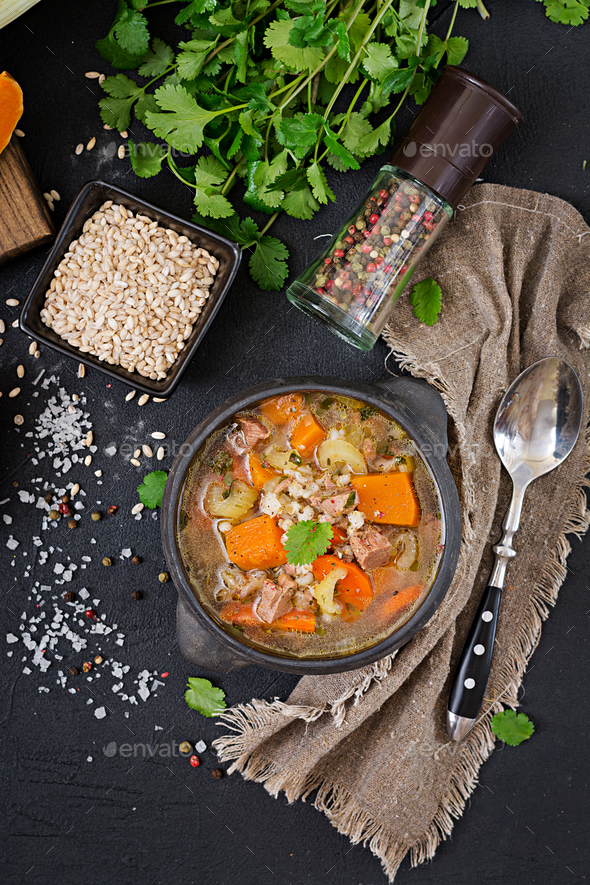 Thick soup with beef, pearl barley, pumpkin and celery. Dietary menu. Top view - Stock Photo - Images