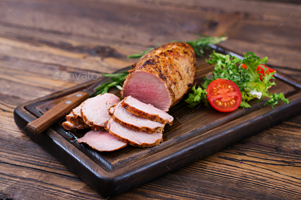 Baked juicy veal fillet in spices on a wooden table. Medium Well. - Stock Photo - Images