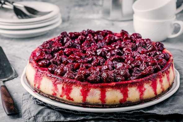 homemade cheesecake with chocolate base and cherry sauce - Stock Photo - Images