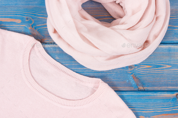 Pink womanly sweater and shawl on old blue boards - Stock Photo - Images
