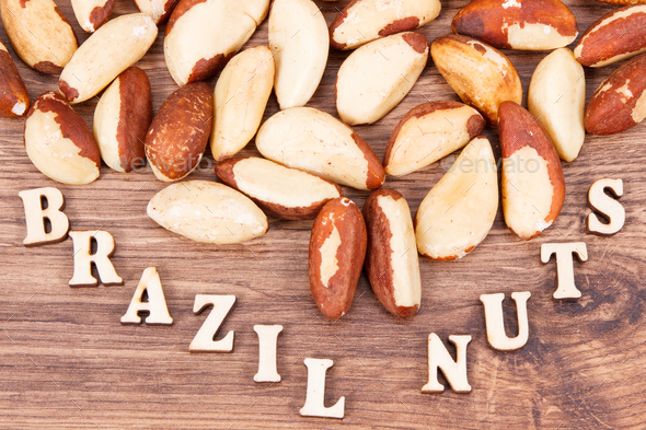 Inscription brazil nuts and fruits containing natural minerals and vitamin - Stock Photo - Images