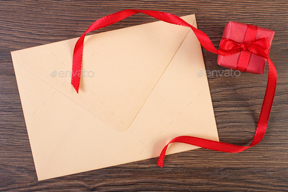 Gift with ribbon and love letter for Valentines Day, copy space for text - Stock Photo - Images