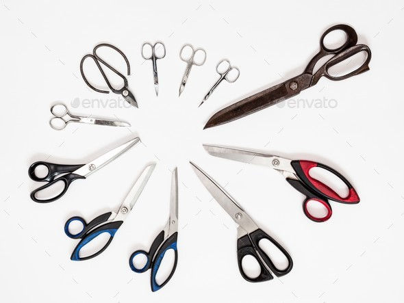 above view of circle from various shears on white - Stock Photo - Images