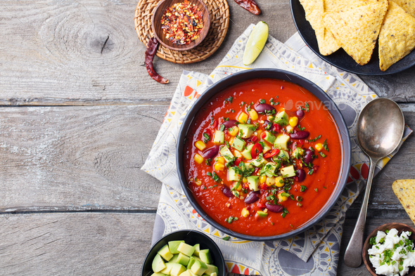 Mexican tomato, bean, bell pepper soup in bowl. - Stock Photo - Images