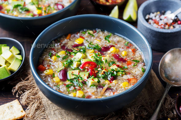 Vegetable quinoa soup stew with avocado corn beans - Stock Photo - Images