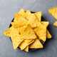 Nachos chips in bowl. Stone background. Top view. - PhotoDune Item for Sale