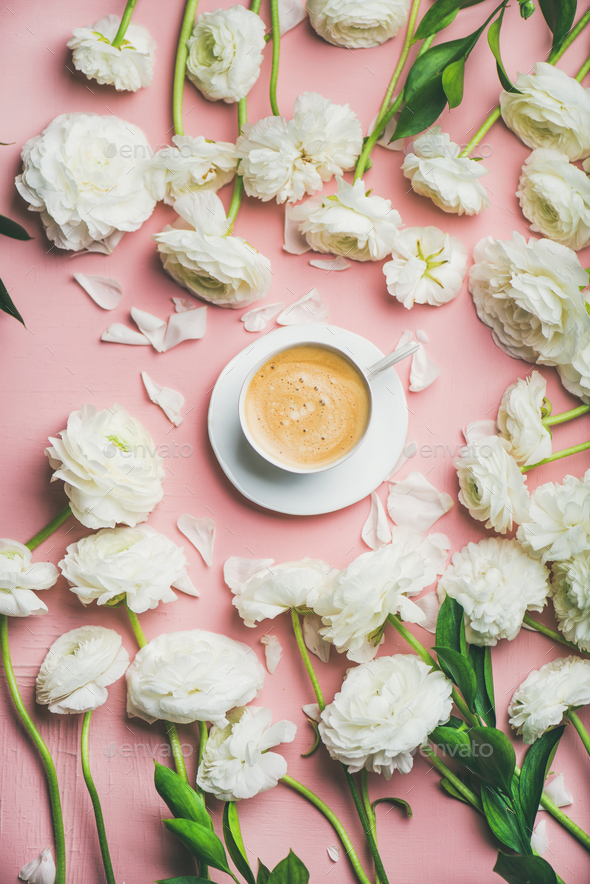 Flat-lay of cup of coffee surrounded with white ranunculus flowers - Stock Photo - Images