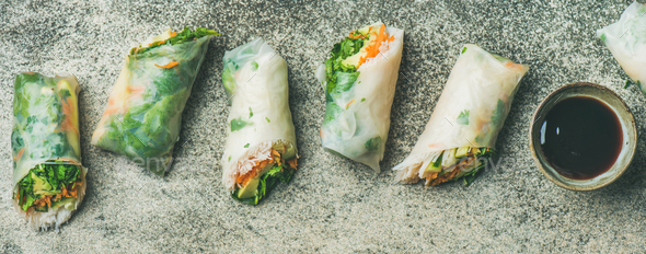 Vegan spring rice paper rolls with chopsticks, wide composition - Stock Photo - Images