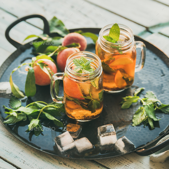 Summer refreshing cold peach ice tea on tray, square crop - Stock Photo - Images