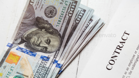 Contact and a stack of bills of one hundred dollars. - Stock Photo - Images
