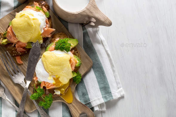 Eggs benedict with salmon background - Stock Photo - Images