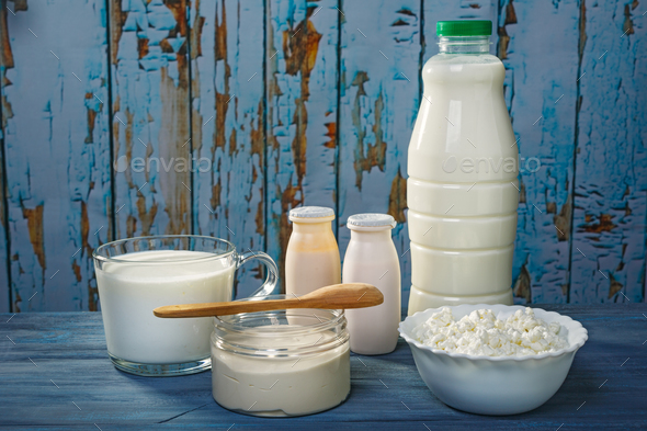 Dairy products on a blue table - Stock Photo - Images