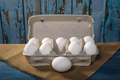 Packing eggs on  wooden background - PhotoDune Item for Sale