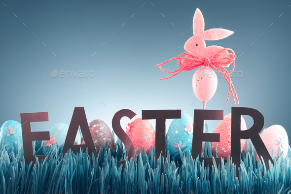 Easter background concept with pink bunny figure - Stock Photo - Images
