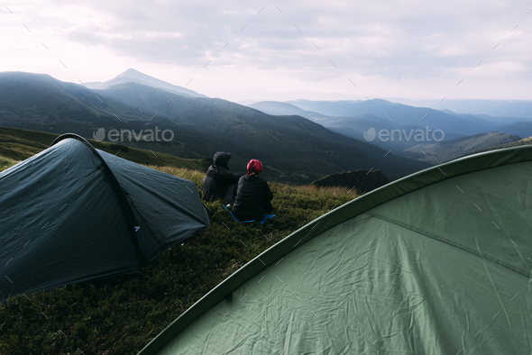 Couple near tent on mountains closeup - Stock Photo - Images