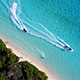 Aerial Shot of Watersports Alongside Incredibly Pristine Tropical Island - VideoHive Item for Sale