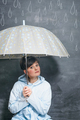 woman under umbrella on drawn by chalk drops of rain background - PhotoDune Item for Sale