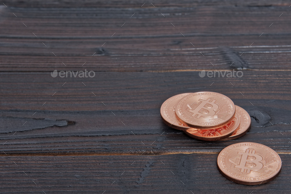Bronze Bitcoins on a table - Stock Photo - Images