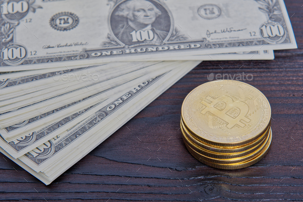 Dollar banknotes and Bitcoins on a table - Stock Photo - Images