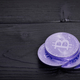 Violet Bitcoins on a table - PhotoDune Item for Sale