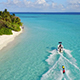 Water Skier and Jet Skier Racing in Front of Beautiful Tropical Island - VideoHive Item for Sale