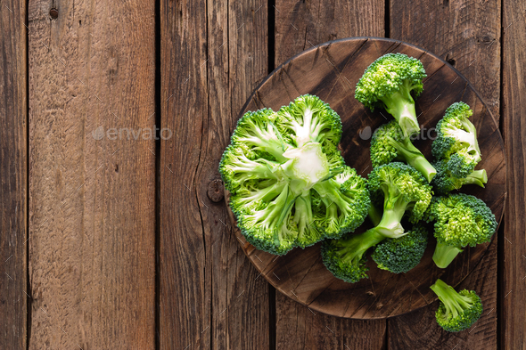 Fresh broccoli on wooden rustic table, top view - Stock Photo - Images