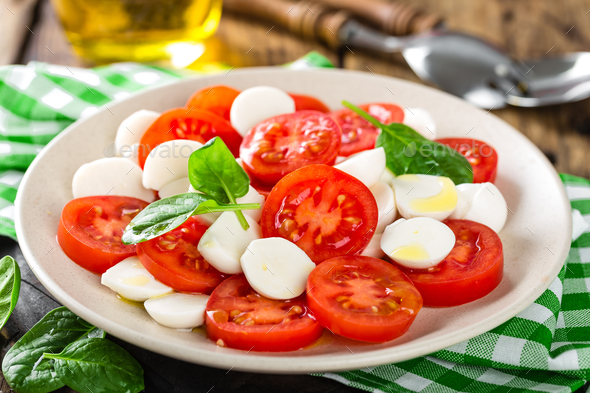 Tomato salad with mozzarella cheese and olive oil - Stock Photo - Images