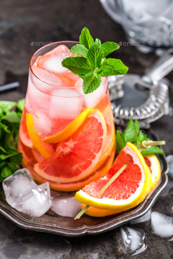 Grapefruit and fresh mint cocktail with juice - Stock Photo - Images