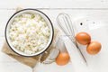 Culinary background with ingredients for cooking, cottage cheese, baking flour, sugar and eggs - PhotoDune Item for Sale