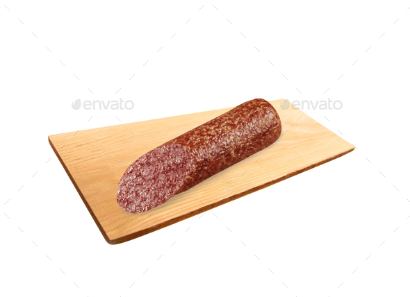 sliced pepperoni sausages on wooden cutting board - Stock Photo - Images