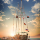 Wooden sailboat at sunset - PhotoDune Item for Sale
