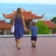 Steadycam Shot of a Young Woman and Her Son Visiting a Budhist Temple Ho Quoc Pagoda on Phu Quoc - VideoHive Item for Sale