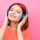 Smiling Redhead Young Woman Listening To Music in Her Headset - VideoHive Item for Sale