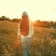 Young Woman Walking in a Meadow in the Sunset - VideoHive Item for Sale