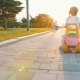 A Little Girl Is Riding on a Kids Car at Park - VideoHive Item for Sale