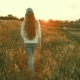 Girl with Long Hair Walking in a Meadow at Sunset - VideoHive Item for Sale