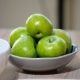 Woman Taking a Fresh Green Apple from a Fruit Bowl in the Kitchen - VideoHive Item for Sale